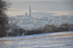 Small town early morning. View from snowy hill to small town early morning Royalty Free Stock Images