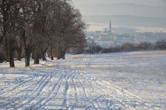 Small town early morning. View from snowy hill to small town early morning Royalty Free Stock Photo