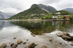 Town of Eidfjord in Norway. Small town of Eidfjord in Norway with clear waters of the fjord Stock Photos