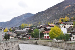 Small Town in Fall. Samll town in fall,which a river is running through. Taken in Songpan,  which is a small minority town and a stopover place to/from Huanglong Royalty Free Stock Images