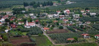 Small town in the field. A picture of a small town near trees and a field,in an area in Greece outside Athens,in a day afternoon of april Royalty Free Stock Photography