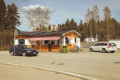 A small town in Finland, a roadside cafe, cars on the road and shops. Summer day of the Finnish town. coffee Jaffa stock image