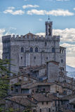 The small town of Gubbio with the Consoli's Palace, blue sky wit Stock Image