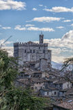 The small town of Gubbio with the Consoli's Palace, blue sky wit Royalty Free Stock Image