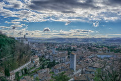 The small town of Gubbio with the Consoli's Palace, blue sky wit Royalty Free Stock Photography