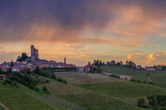 Small town on the hill under cloudy sky in Italy. Royalty Free Stock Photos