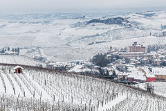 Small town and hills of Langhe in winter. Stock Image