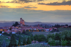 Small town on the hills at sunset in Italy. Stock Photo