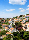 Small town houses under blue sky. Bunch of houses from small town under the blue sky near Dubrovnik, Croatia. Image good for residential or travel banners, book royalty free stock photography