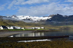 Small town of Kirkjufell on the shore of the lake in the west of Iceland royalty free stock photography