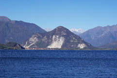 Small town on lake Maggiore and mountain Alps Stock Photos