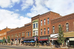 Small Town Main Street. A photo of a typical small town main street in the United States of America. Features old brick buildings with specialty retail shops and Royalty Free Stock Photography