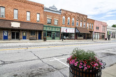 Small Town Main Street. A photo of a typical small town main street in the United States of America. Features old brick buildings with specialty shops and Royalty Free Stock Image