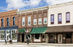 Small Town Main Street. A photo of a typical small town main street in the United States of America. Features old brick buildings with specialty shops and Stock Photos