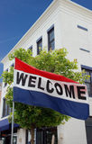 Small Town Main Street Welcome Flag. A flag welcoming visitors into a small town shopping district Stock Photos