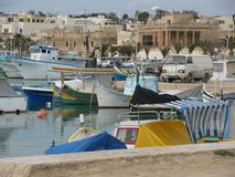 Colorful fishing boats in the port. Malta. Marsaxlokk. A small town in Malta Marsaxlokk. The harbor is full of colorful boats ready to go out to sea to fish Royalty Free Stock Photos