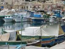 Colorful fishing boats in the port. Malta. Marsaxlokk. A small town in Malta Marsaxlokk. The harbor is full of colorful boats ready to go out to sea to fish Royalty Free Stock Image