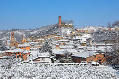Small town and medieval tower covered with snow. Stock Images