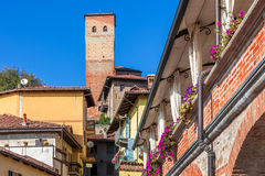 Small town with medieval tower in Piedmont, Italy. Royalty Free Stock Photography