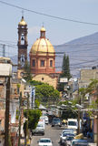 Small town Mexico. Looking down a small street towards a Cathedral Church in a small town, Mexico Stock Photography