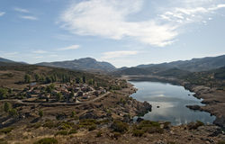 Small Town Near a Reservoir. The village of Triollo, next to reservoir Camporredondo, Palencia, Spain Stock Images