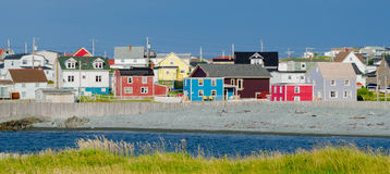 Small town Newfoundland.  Multi color houses line streets in villages across newfoundland Royalty Free Stock Photo