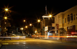 Small Town Nightfall with Streaming Headlights Stock Images