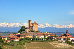 Small town with old castle on the hill in Piedmont, Italy. Stock Photos
