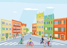 Small town with pedestrians and bicyclists Royalty Free Stock Photo