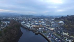 Small town beside a river & x28;drone& x29;. Small town in Ireland beside a river and the sea. During golden hour Stock Photo