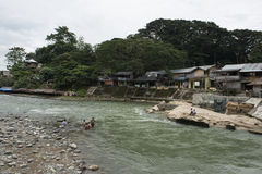 Small town on the river in the jungle of Sumatra, Indonesia. Stock Image
