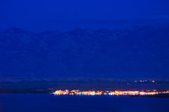 Small town between sea and mountains at night Stock Photography