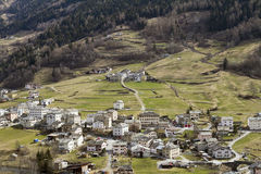 Small town at slope of Alp mountain Stock Image