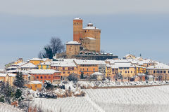 Small town on snowy hill in Italy. Royalty Free Stock Images