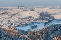 Small town among snowy hills in Italy. Royalty Free Stock Images