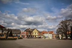 Small town. Town square in centre of  Tukums, Latvia. Small cozy town with historic buildings. Nice blue sky and clouds in the background Royalty Free Stock Photos