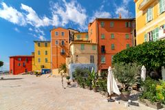 Small town square and colorful houses in Menton stock image