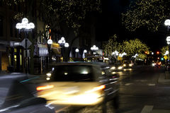 Small town street. Small town night scene, with lights and moving cars Royalty Free Stock Photography