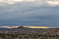 Small town at sunset. Small town in Montana at sunset with storm on the way Royalty Free Stock Photos