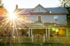 Small town USA country home with sun star and spots Stock Photo