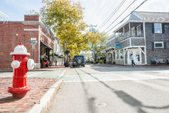 Small town, USA. EDGARTOWN, USA - OCTOBER 16, 2014; Small town USA on Martha's Vineyard, Cape Cod with its quaint buildings and street scenes as people pass the Stock Image