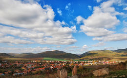 Small town in the valley. Hungarian town with white clouds backgound Stock Photo