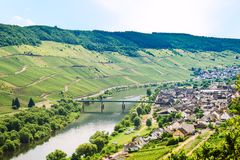 Small town in valley of Mosel river. Travel to Germany - small town in valley of Mosel river in Cochem - Zell region on Moselle wine route in sunny summer day Royalty Free Stock Image