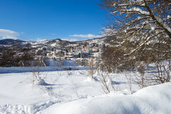 Small town in the winter snow in Italy Stock Image