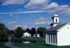 Small town worship. A small towns church looking over a pond and farm Royalty Free Stock Photo