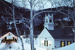 Small town worship. A snow covered little village Royalty Free Stock Photos