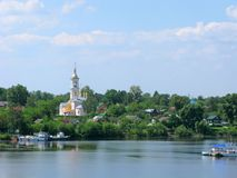 Small towns of Russia, Kimry, Tver region, Volga river. Small towns of Russia. Kimry, Tver region. Panorama of the city with Lord`s ascension temple and wooden royalty free stock image