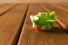 Small toy airplane on wooden background. Travel concept royalty free stock images