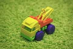 Small toy - car on carpet Royalty Free Stock Images