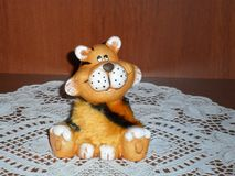 Sitting toy tiger cub royalty free stock photography